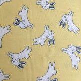 Tissu coton petit lapin jaune